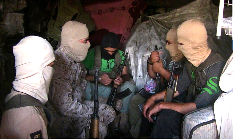 Combatants of Hay'at Tahrir al-Sham on the fronts of the Kurds mountain area in the countryside of Lattakia - July 2018 (Ebaa Agency)