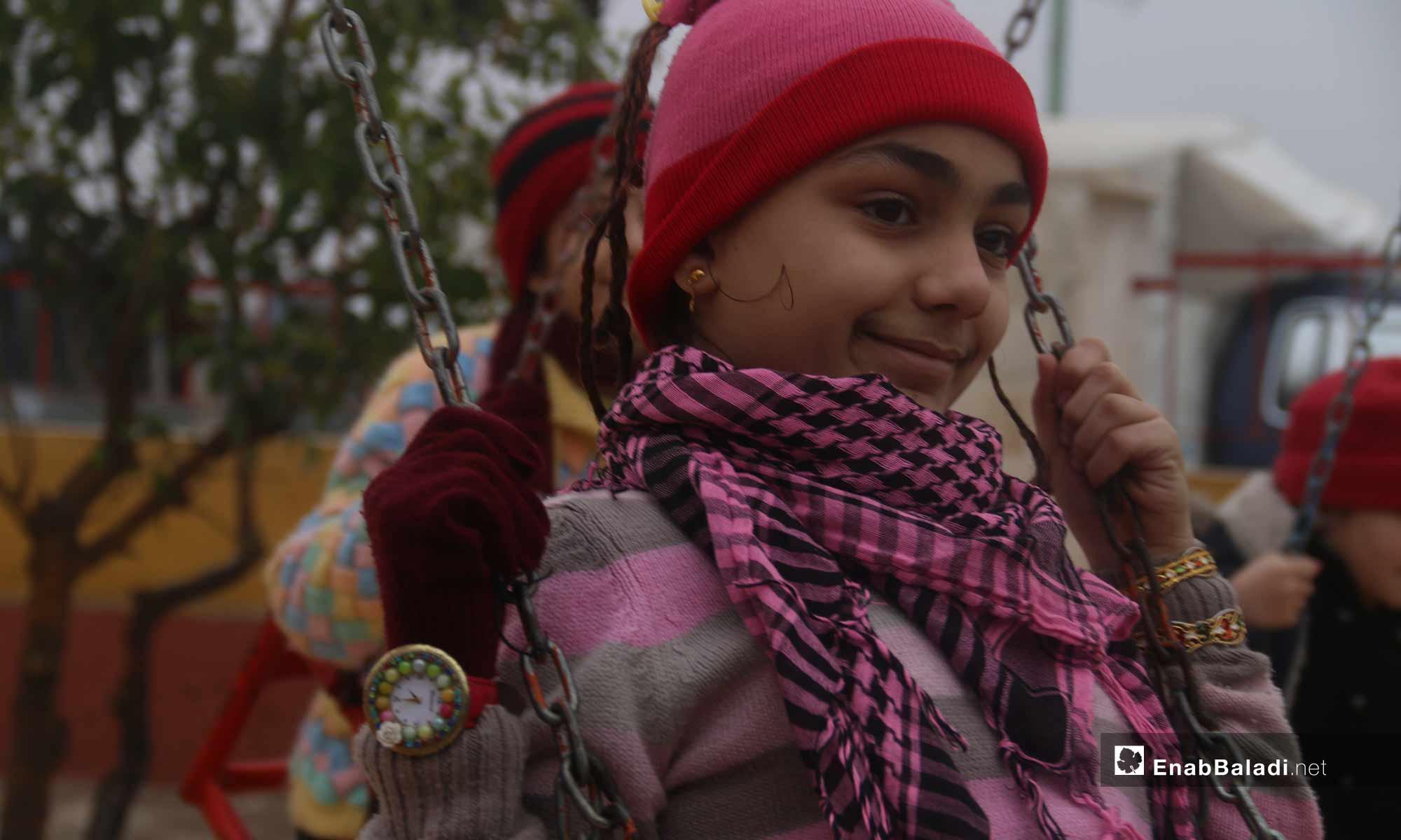 Children play at the al-Dalah Park in the city of Maarrat al-Nu