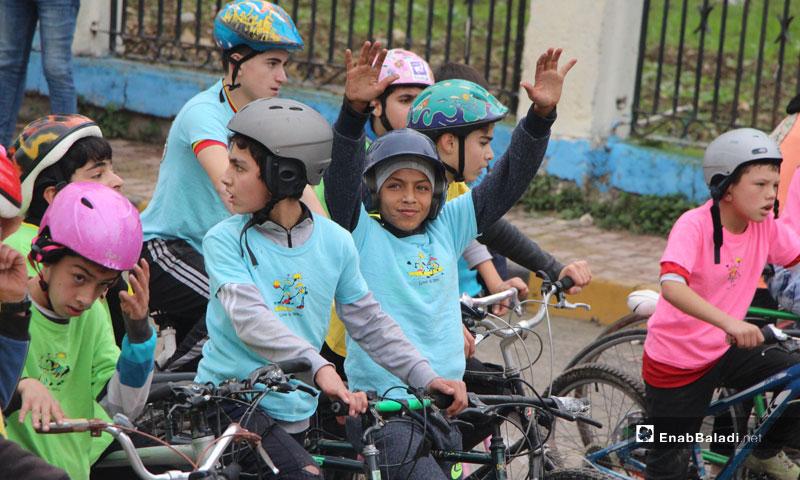 The first kids cycling marathon in Jisr al-Shugur organized by the Syrian Civil Defense - December 11, 2018 (Enab Baladi)