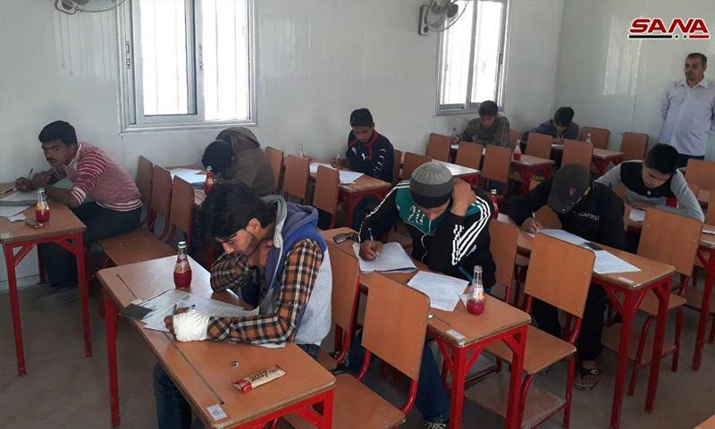 Eastern Ghouta's preparatory school exams, held at the makeshift housing center in al-Horjelah – May 13, 2018 (SANA)