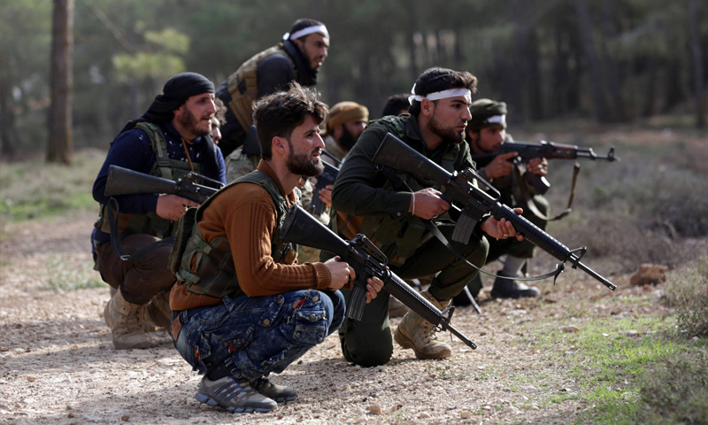 """""""Free Army"""" troops at a battle, north Afrin – March 6, 2018 (Reuters)"""