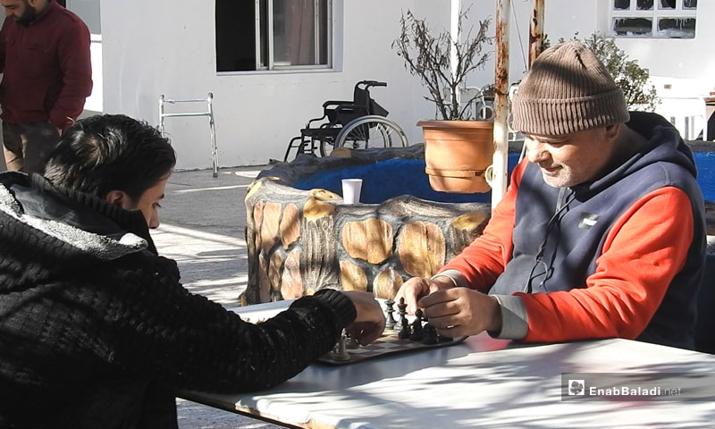 Two persons with disabilities playing chess in the center – January 2, 2019 (Enab Baladi)