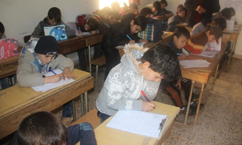 Children during exams in a home class at the town of Haiian, rural Aleppo – December 15 (Haiian Media Office)