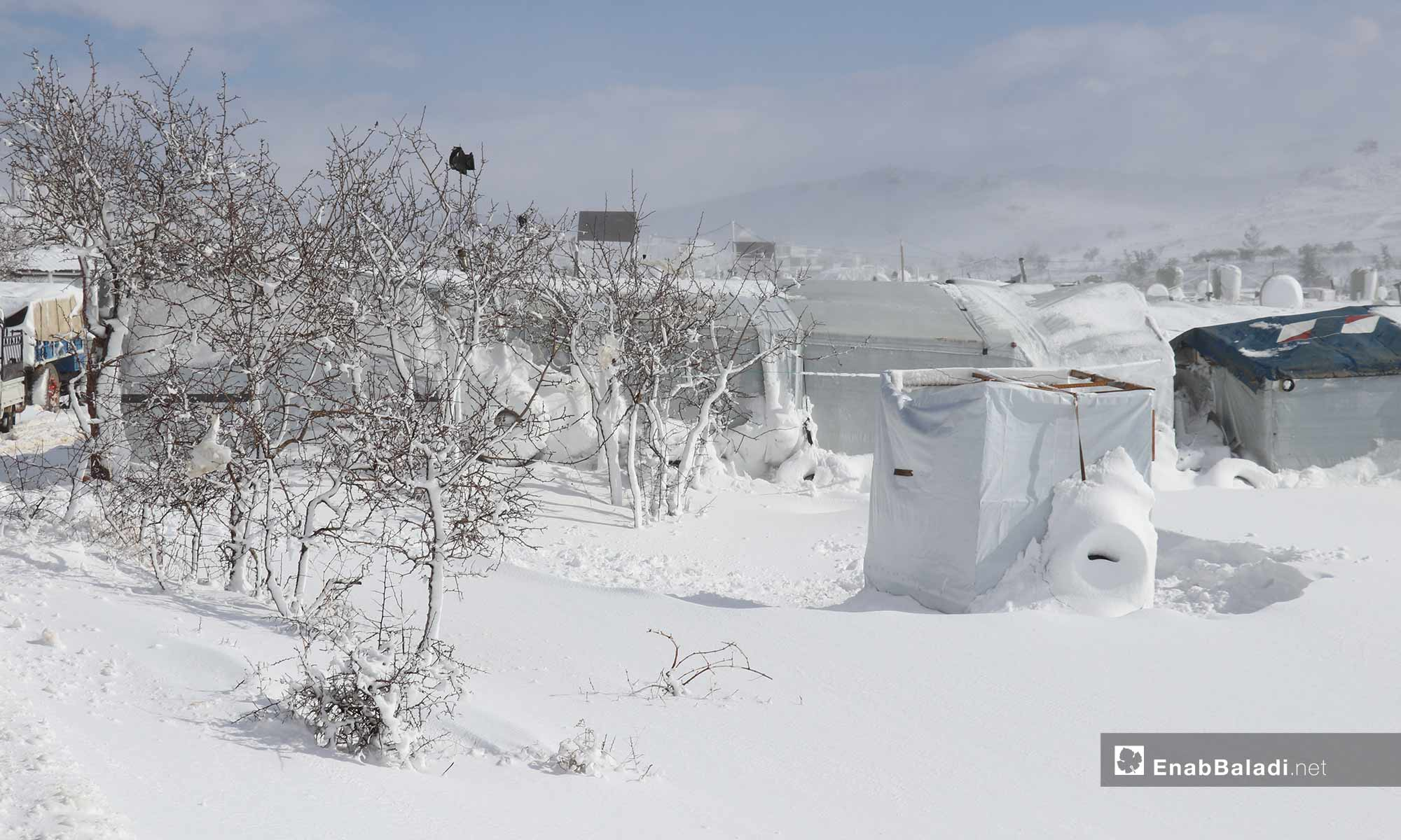 Tents covered with snow in Arsal camps in Lebanon, 9 January 2019 (Enab Baladi)