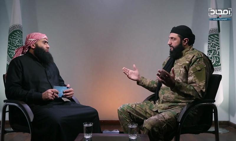 "Abu Mohammad al-Julani, commander-in-chief of ""Tahrir al-Sham,"" in a video interview - January 14, 2018 (Amjad)"