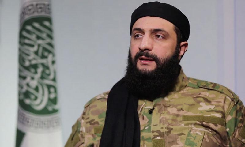 "Abu Mohammad al-Julani, Commander-in-Chief of ""Tahrir al-Sham"" (Amjad Media)"