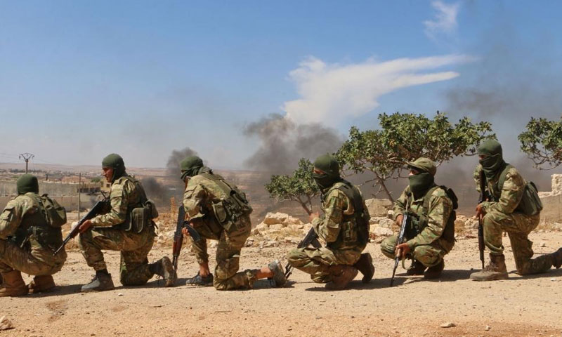 """Troops of the """"National Front"""" in a training camp, rural Idlib – 2018, (Aref Watad, AFP)"""