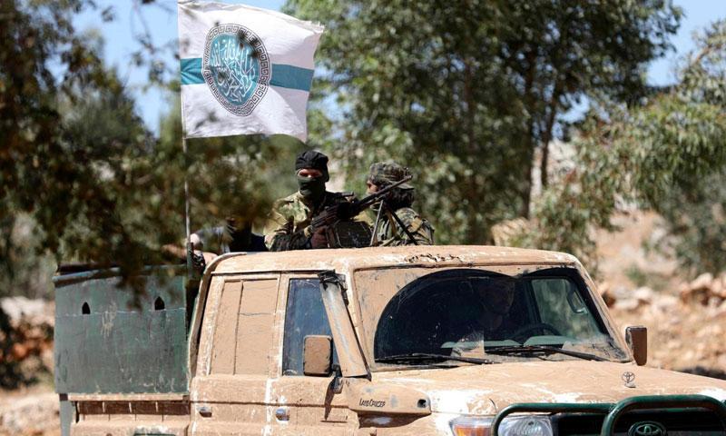 "Troops of ""Tahrir al-Sham"" boarding a car in a training camp, rural Idlib – August 14, 2018 (Omar Haj Qadour-AFP)"