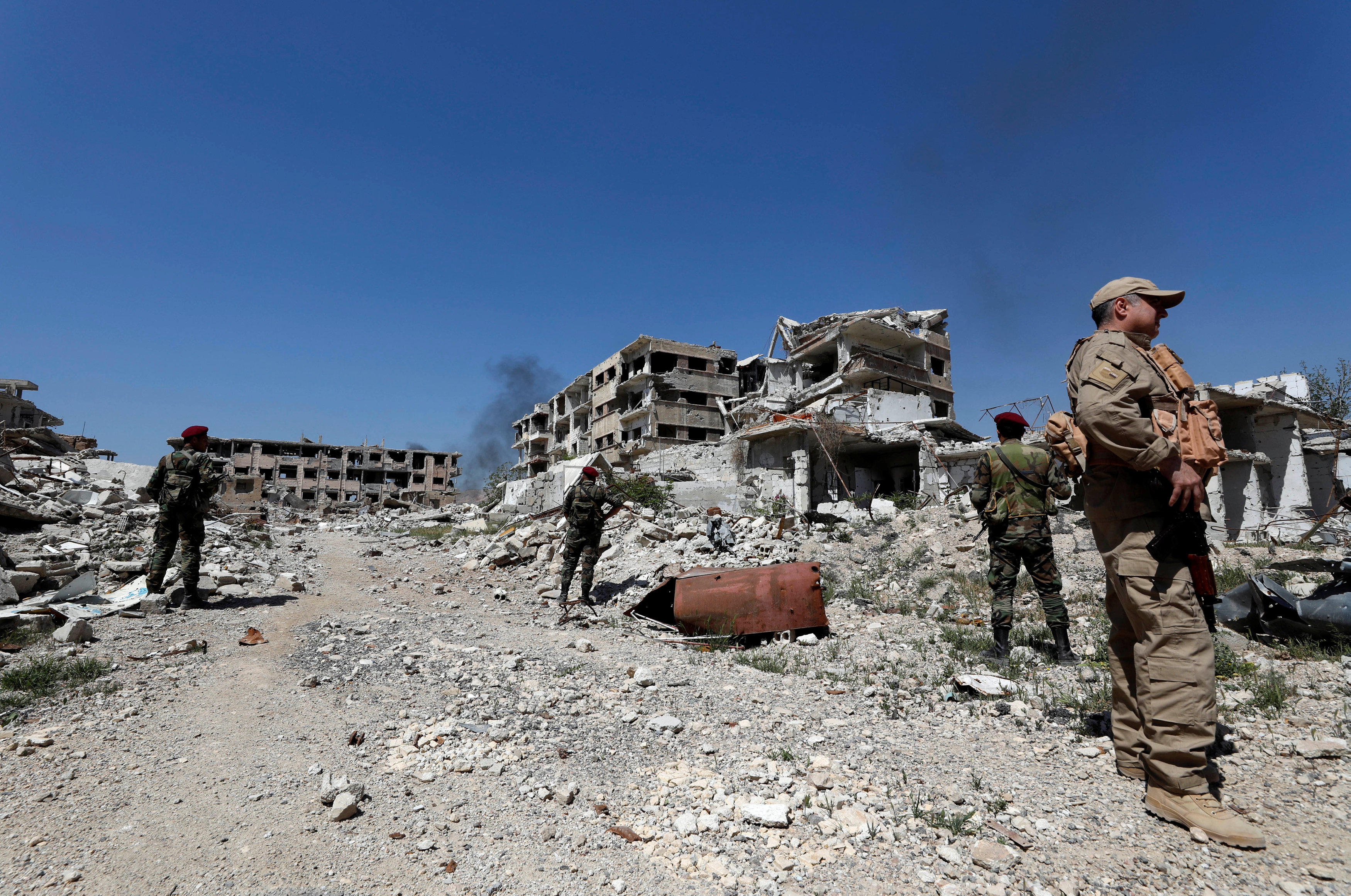 Russian troops and Syrian forces guarding the place, where al-Assad forces targeted Duma city with chemical weapons - May 2018 (Reuters)