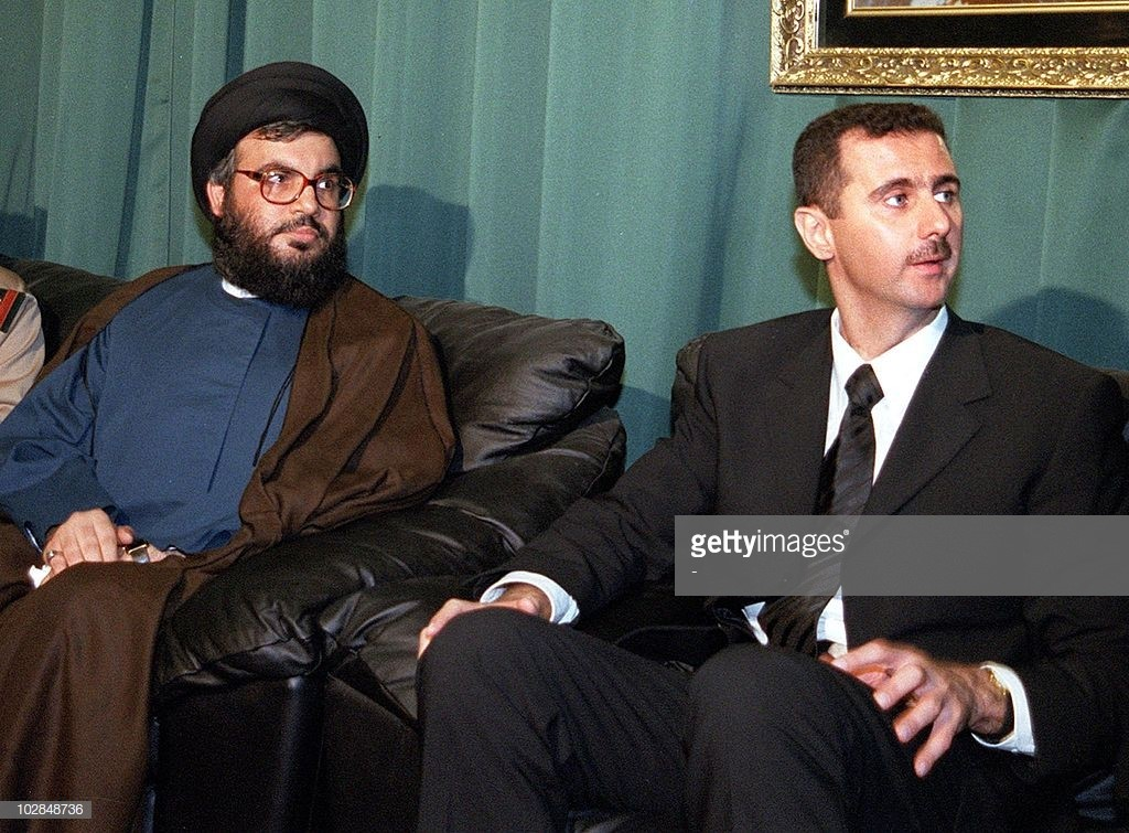 Hezbollah's Hassan Nasrallah offering Syrian heir president Bashar al-Assad, on June 15 2000, his condolences over the death of his father Hafez al-Assad. AFP/Getty Images.