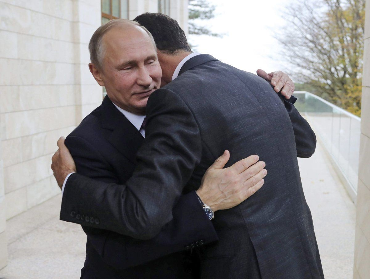 """""""A hug that says volumes about the situation in Syria"""" Washington Post. 2017 (Mikhail Klimentyev/AP)"""
