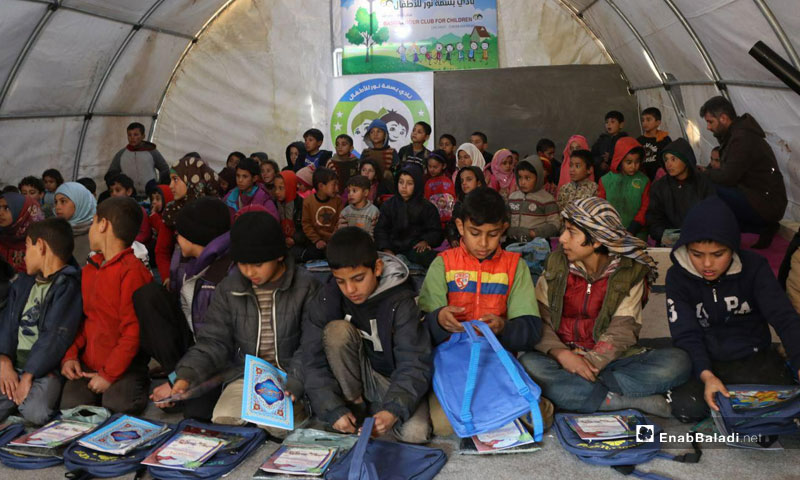Students receiving their education under the supervision of the Basmat Nour/Smile of the Light Educational Team at the al-Iman camp, Southern Idlib – February 7, 2019 (Enab Baladi)