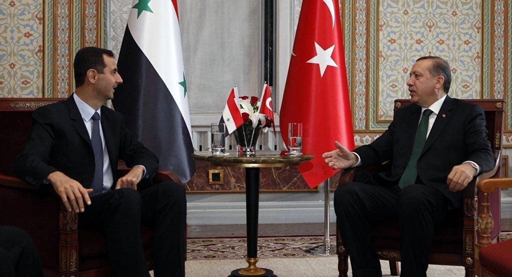 Turkish President Recep Tayyip Erdogan and Syrian President Bashar al-Assad at a meeting in Istanbul – 2010 (AP)