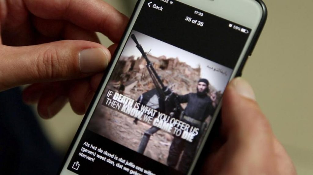 A mobile device playing a video on ISIS (expressive from the Internet)