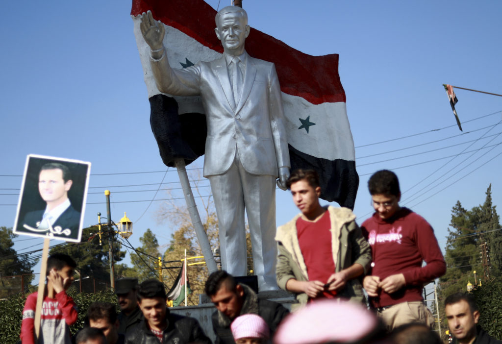 Young men march in support of the Syrian regime in Qamishli – December, 2018 (afp)