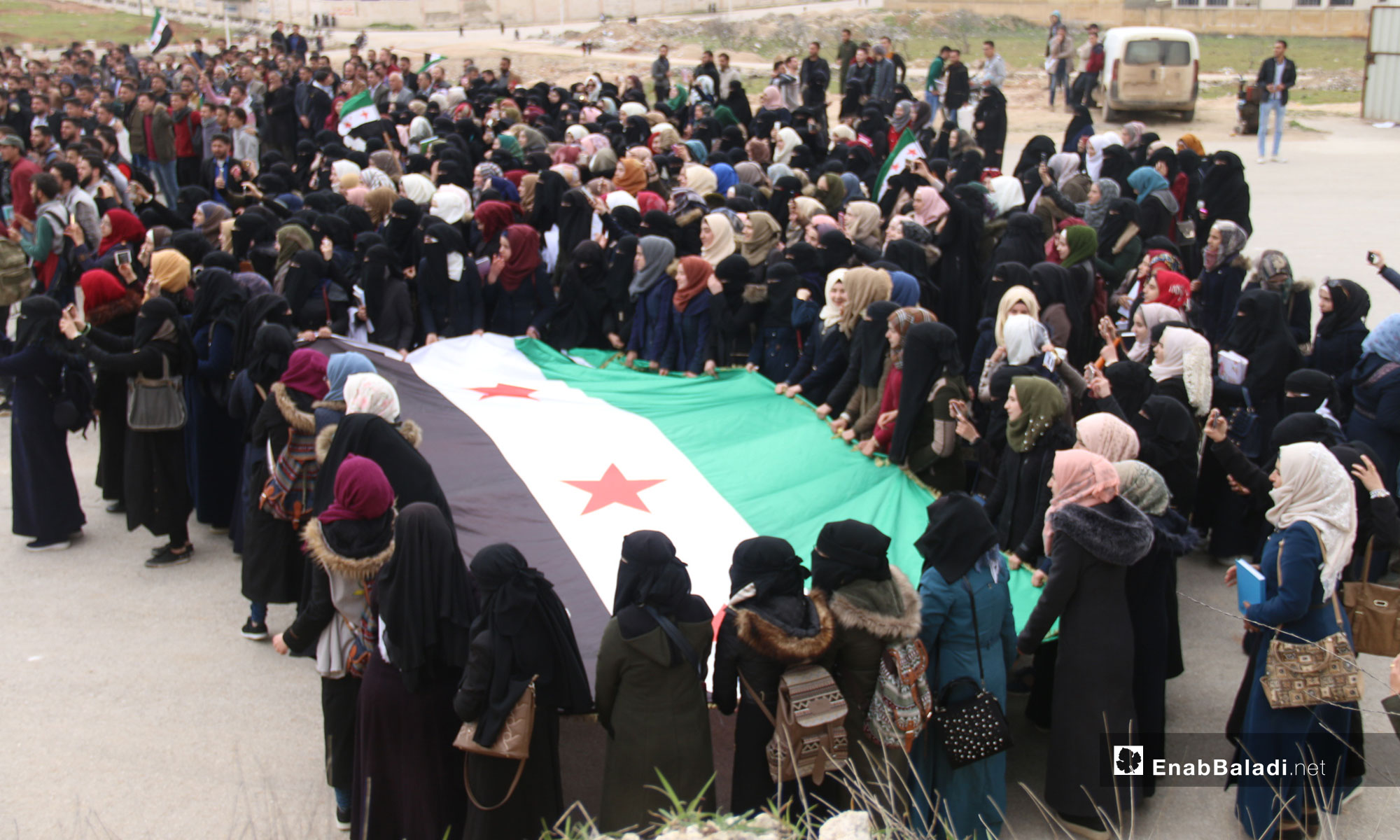 A demonstration by Idlib University students on the Syrian revolution's eighth anniversary – March 18, 2019 (Enab Baladi)