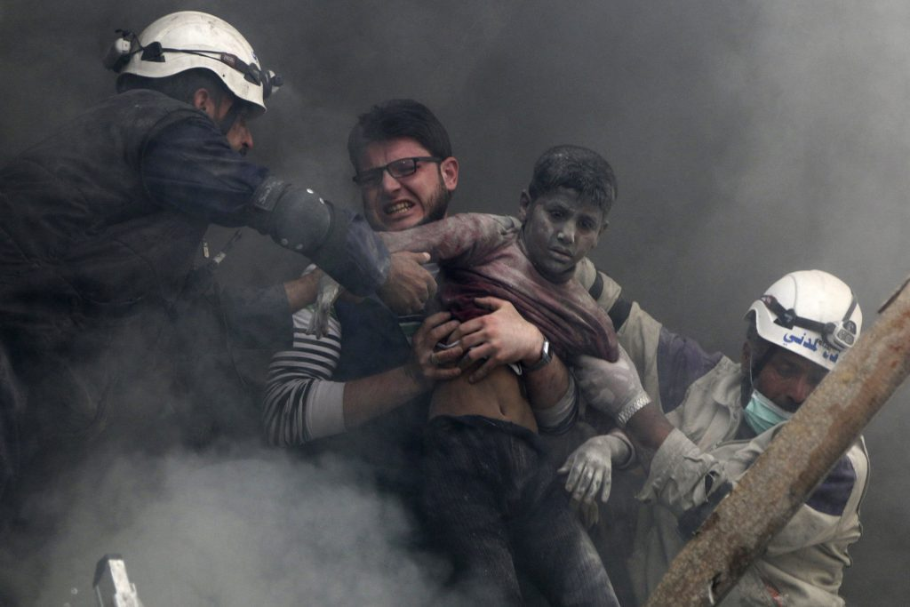 A picture of the civil defense elements saving a child trapped under the rubble (movie: Last Men in Aleppo)
