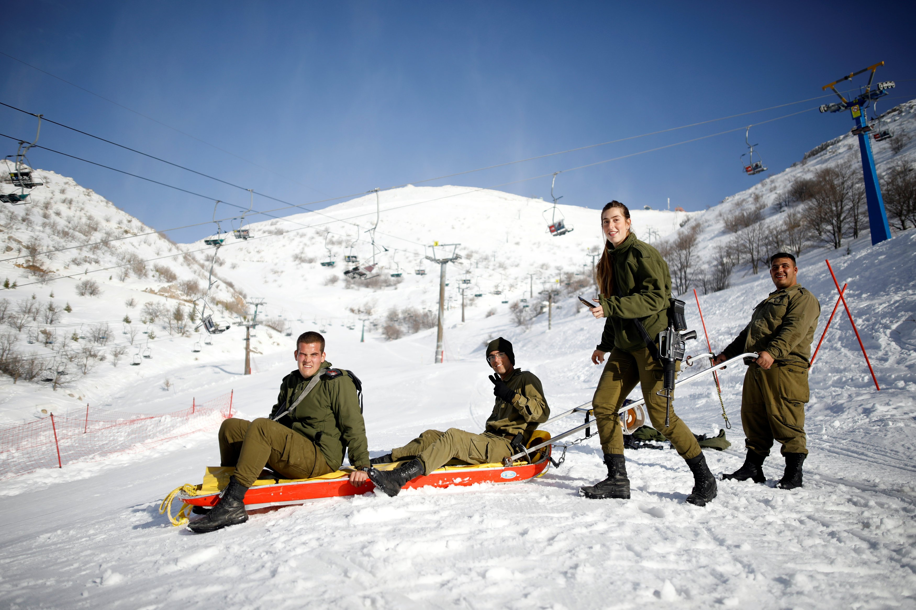 Israeli soldiers on a sled in Mount Hermon in the Israeli-occupied Golan Heights near Israel - January 2019 (Reuters)