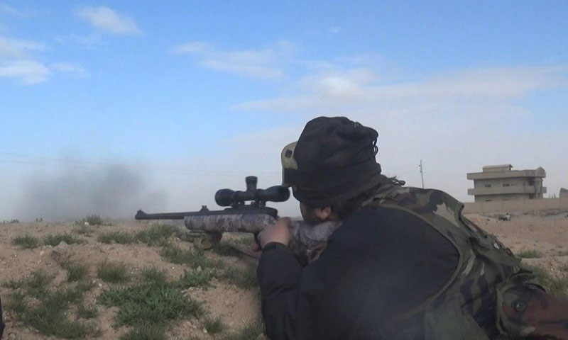 An IS militant during confrontations with SDF in the town of al-Susah, eastern rural Deir ez-Zor – February 2019 (Amaaq)