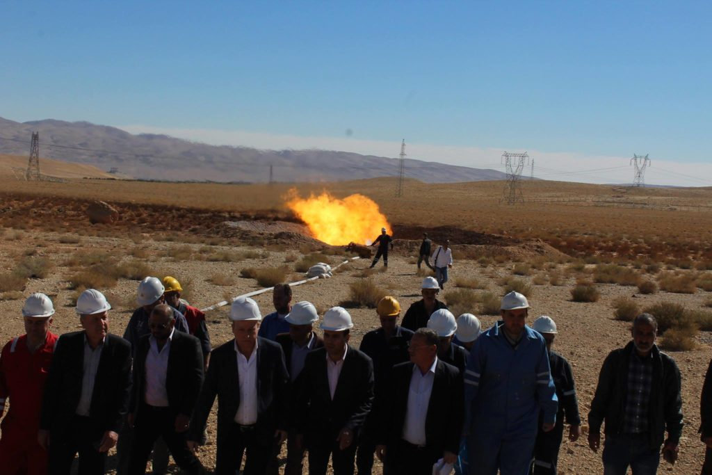 Syrian Minister of Petroleum and Mineral Resources, Ali Ghanem, accompanied by Governor of Homs, Talal al-Barazi, during a visit to an oil field in the eastern countryside of Homs, November, 2018 (Ministry of Petroleum and Mineral Resources)