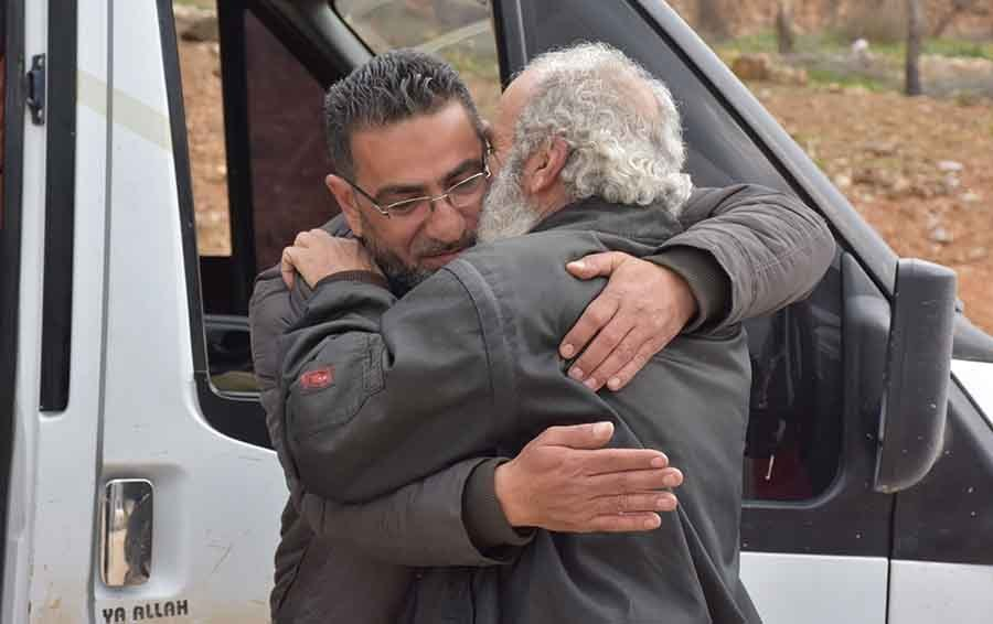 Detainees released by the Syrian regime during a swap deal in Aleppo - February, 2019 (Anadolu Agency)