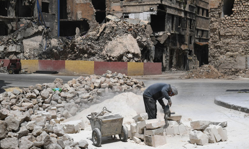 A Syrian worker cuts stone during the restoration of the 14th-century Suhaibi Mosque in the Old City of Aleppo - April 22, 2018 (AFP)