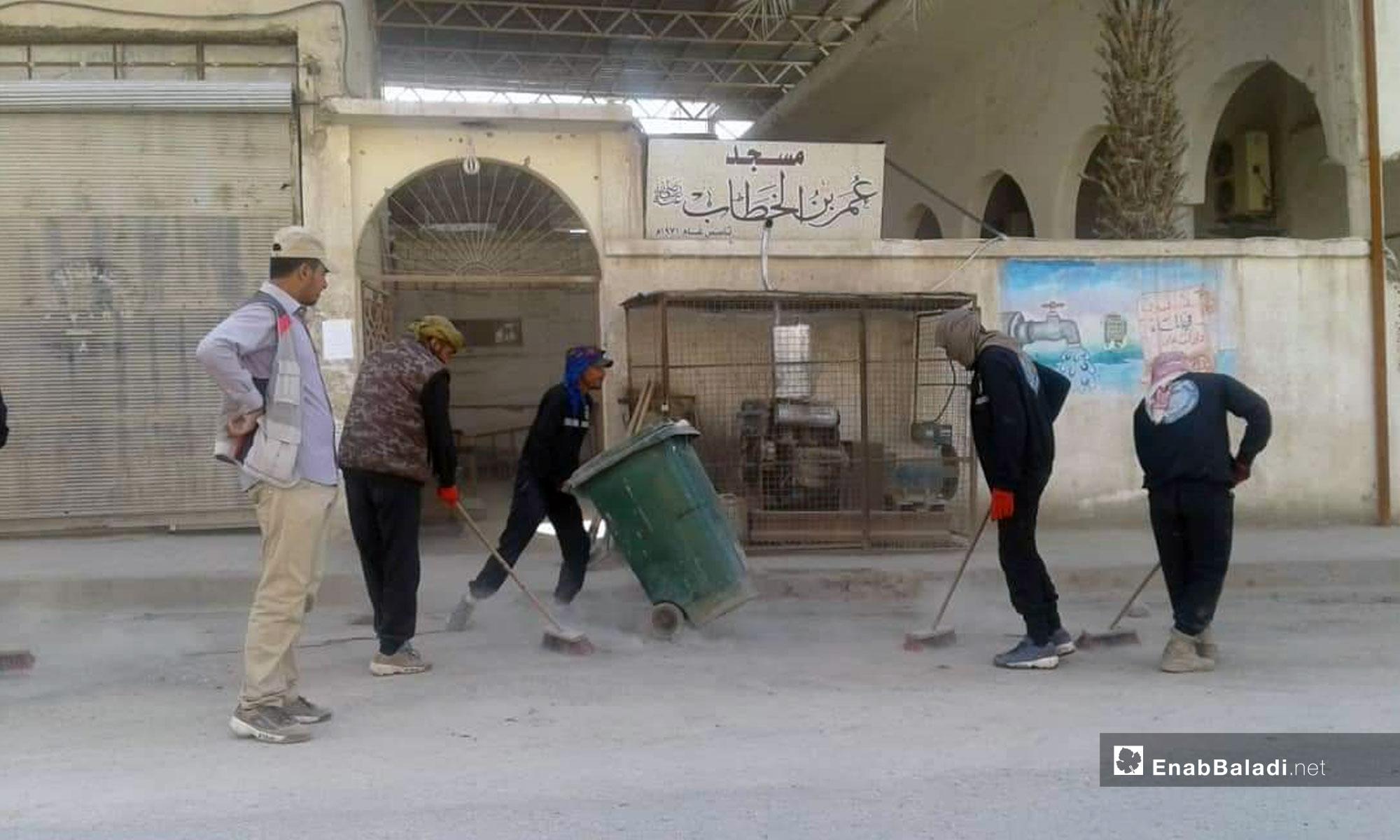 Cleaning Raqqa city's streets on the first days of Ramadan - May 8, 2019 (Enab Baladi)