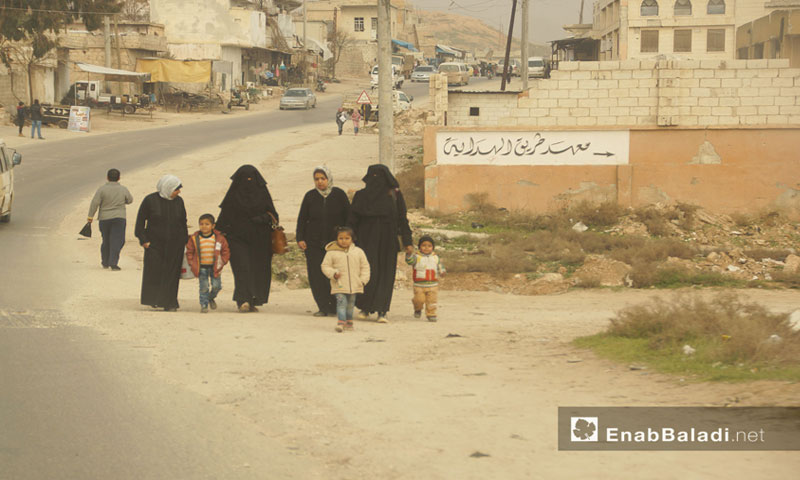 Women with their children in the town of Almastumah in rural Idlib - 13 January 2018 (Enab Baladi)