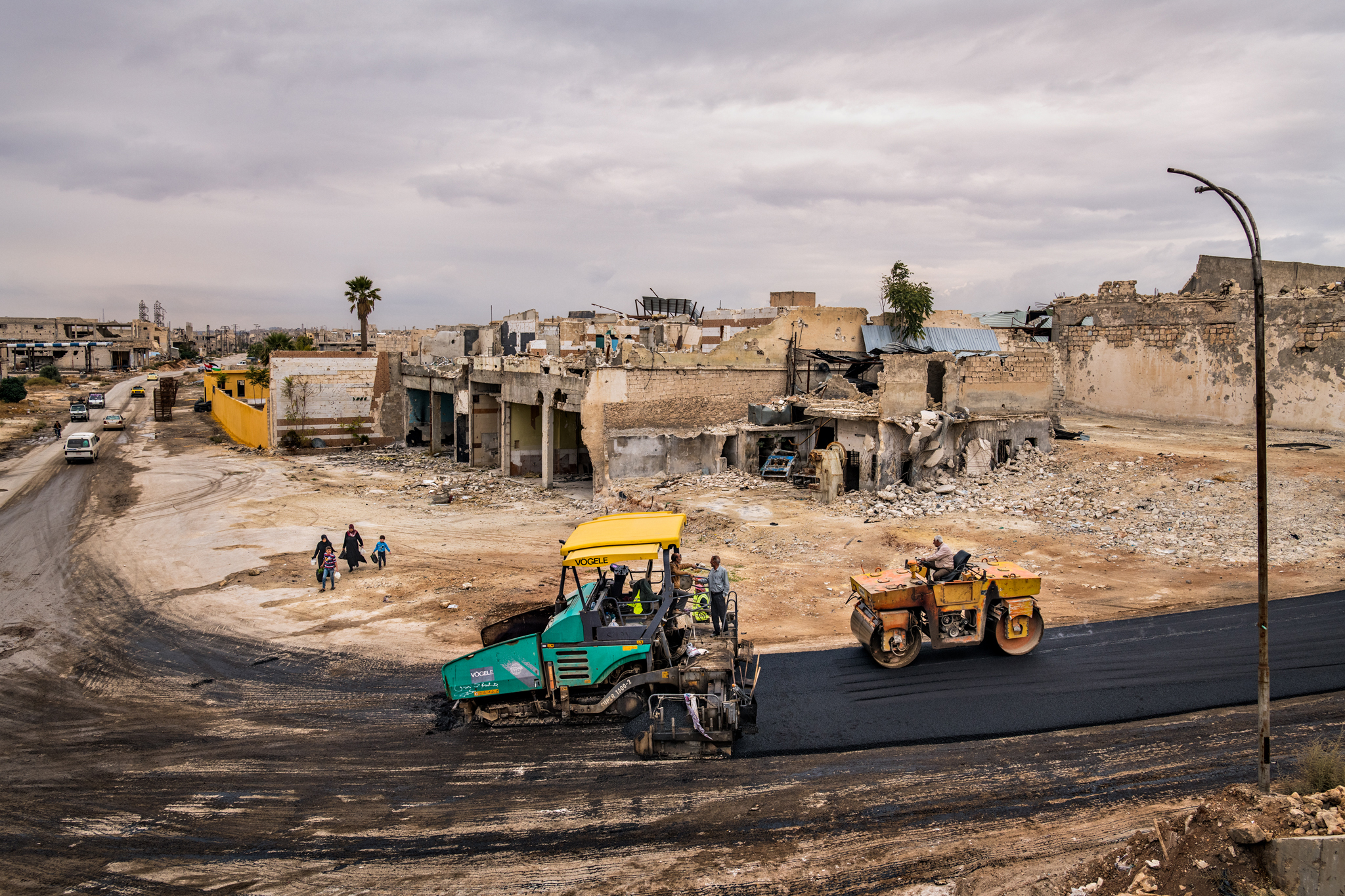 Construction workers carrying out asphalting works near Aleppo Airport in east Aleppo - February 2019 (National Geographic)