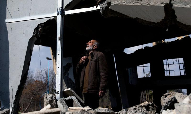 Afandi Abu Saow, Armenian Christian, standing near the remains of an Armenian church I Raqqa, which received several aerial attacks during the prayers – 24 February, 2018 (NurPhoto)