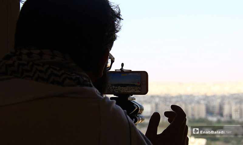 """A shot from the """"Behind-the-Scenes"""" movie by Syrian photographer and media activists Fuad Halaq (Enab Baladi)"""