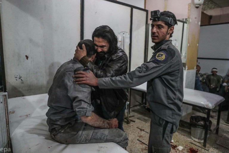 Members of the Civil Defense consoling each other after the death of three SCD members in eastern Ghouta - 21 November 2017 (EPA Mohammed Badra)