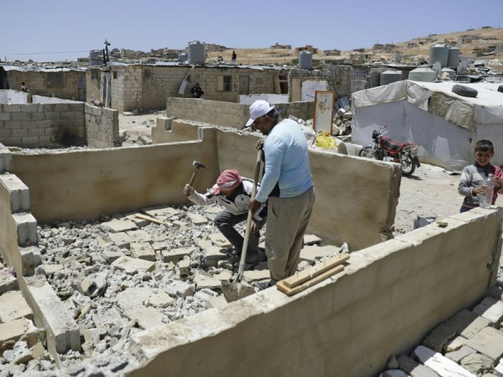 Refugees demolishing cement walls in the Arsal camps - June 2019 (AFP)