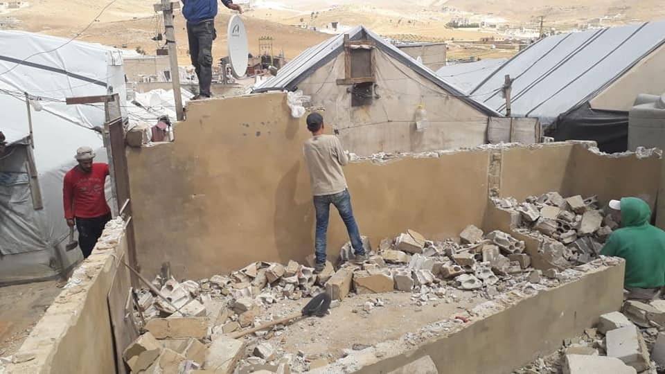 A Syrian refugee demolishing his house in a Lebanese refugee camp 2019 (Voice of Refugee on Facebook)