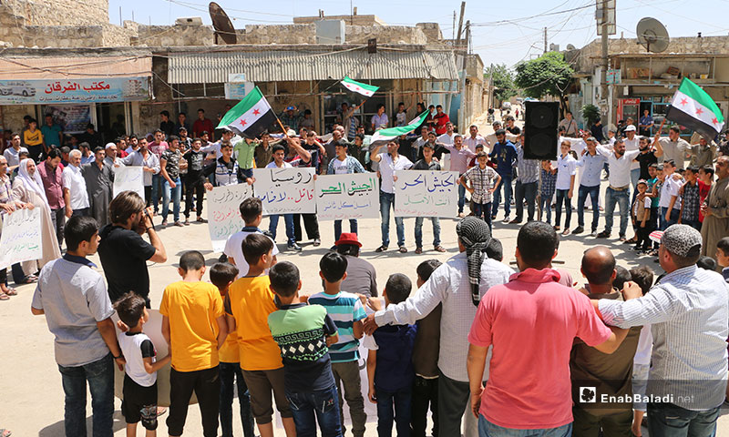 """A demonstration in the city Marea, northern rural Aleppo. The signs carried by the demonstrators say: """"You Are The Hope, Free Army!/ Russia, A Murderer, Not a Guarantor/ The Free Army Is The Hope for Every Revolutionary/ The Revolution of Freedom, The Revolution of Justice, The Revolution Of Dignity, Is Ongoing"""" – June 7, 2019 (Enab Baladi)"""