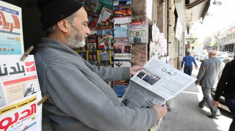 Syrian reading al-Baath newspaper - December 2, 2018 (Internet)