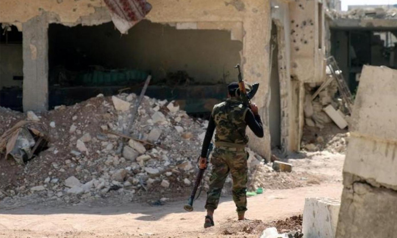 Militant of the Free Syrian Army (FSA) carrying an individual weapon in rural Daraa – 2017 (Reuters)