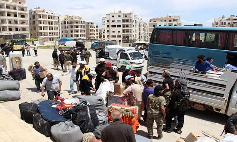 Displaced Palestinians from Yarmouk camp awaiting transfer to Hama - 2018 (Al-Arabi Al-Jadeed)