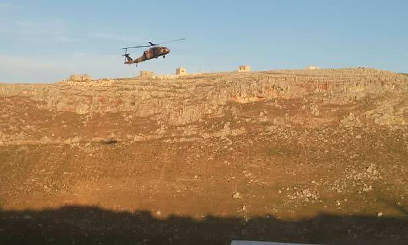 A Turkish helicopter hovering above the observation pots in Shair al-Maghar after its evacuation of wounded Turkish soldiers in northern rural Hama – (Enab Baladi)