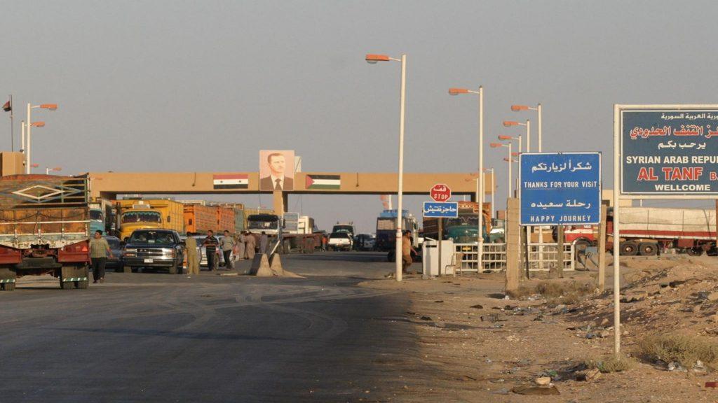 Vehicles waiting at al-Tanf Syrian-Iraqi border crossing - October 14, 2019 (AP)