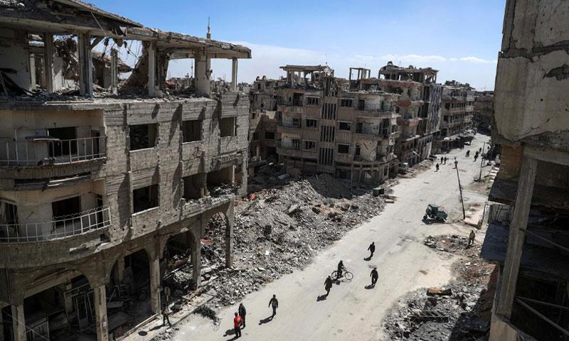 Douma residents in the eastern Ghouta( EPA)