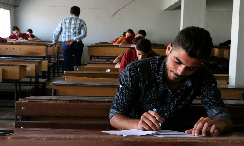 Student sitting for an exam in Free Idlib University, 2018 (University Facebook account).