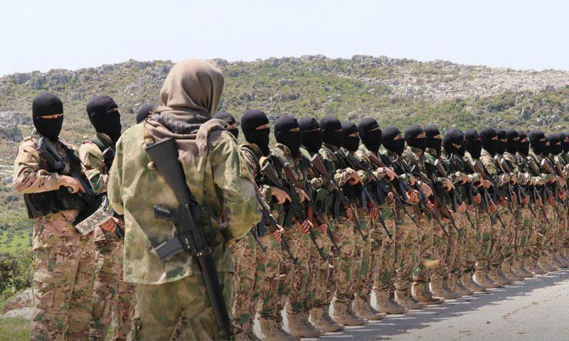 Personnel of the al-Tawhid wal-Jihad Brigade, under Hayat Tahrir al-Sham, rural Idlib – April 2019 (Ebaa Agency)