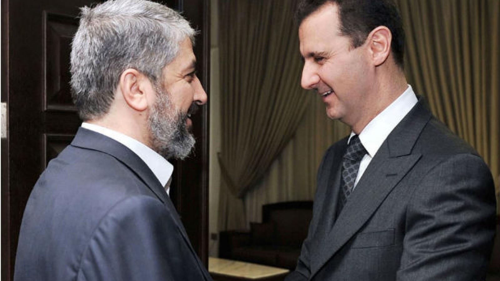 Head of the Hamas Political Bureau, Khaled Meshaal, with Syrian President Bashar al-Assad (Reuters)