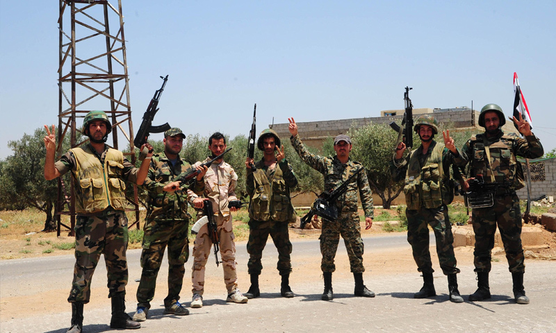 Assad Forces' personnel taking a photo in rural Daraa – July 2018 (Reuters)