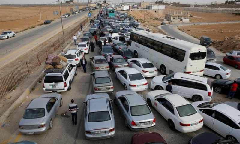 Vehicles awaiting entry into Syria via the Nassib border crossing (Reuters)