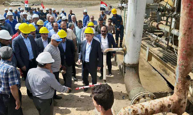 Minister of Oil and Mineral Resources, Eng. Ali Ghanem, on a visit to al-Taim oil field in Deir ez-Zor - May 2019 (Syrian Ministry of Oil on Facebook)