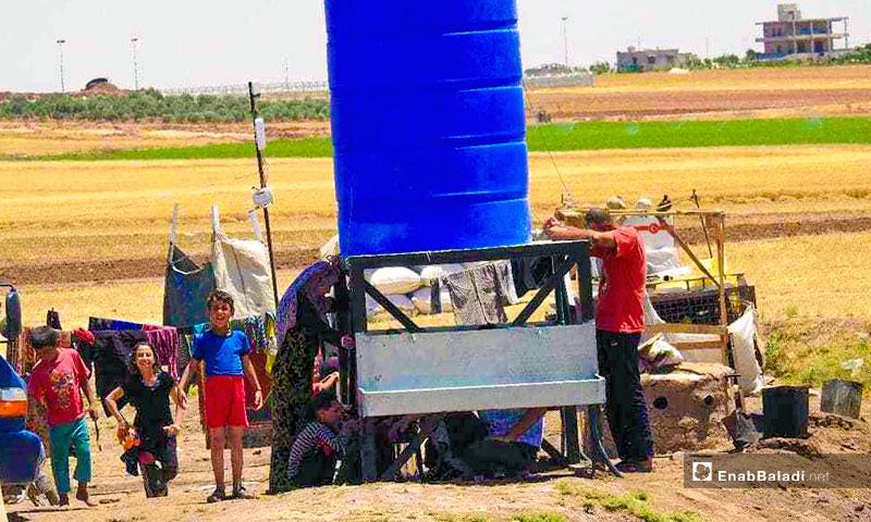 Distribution of water in Camp Marj Dabiq (Enab Baladi)