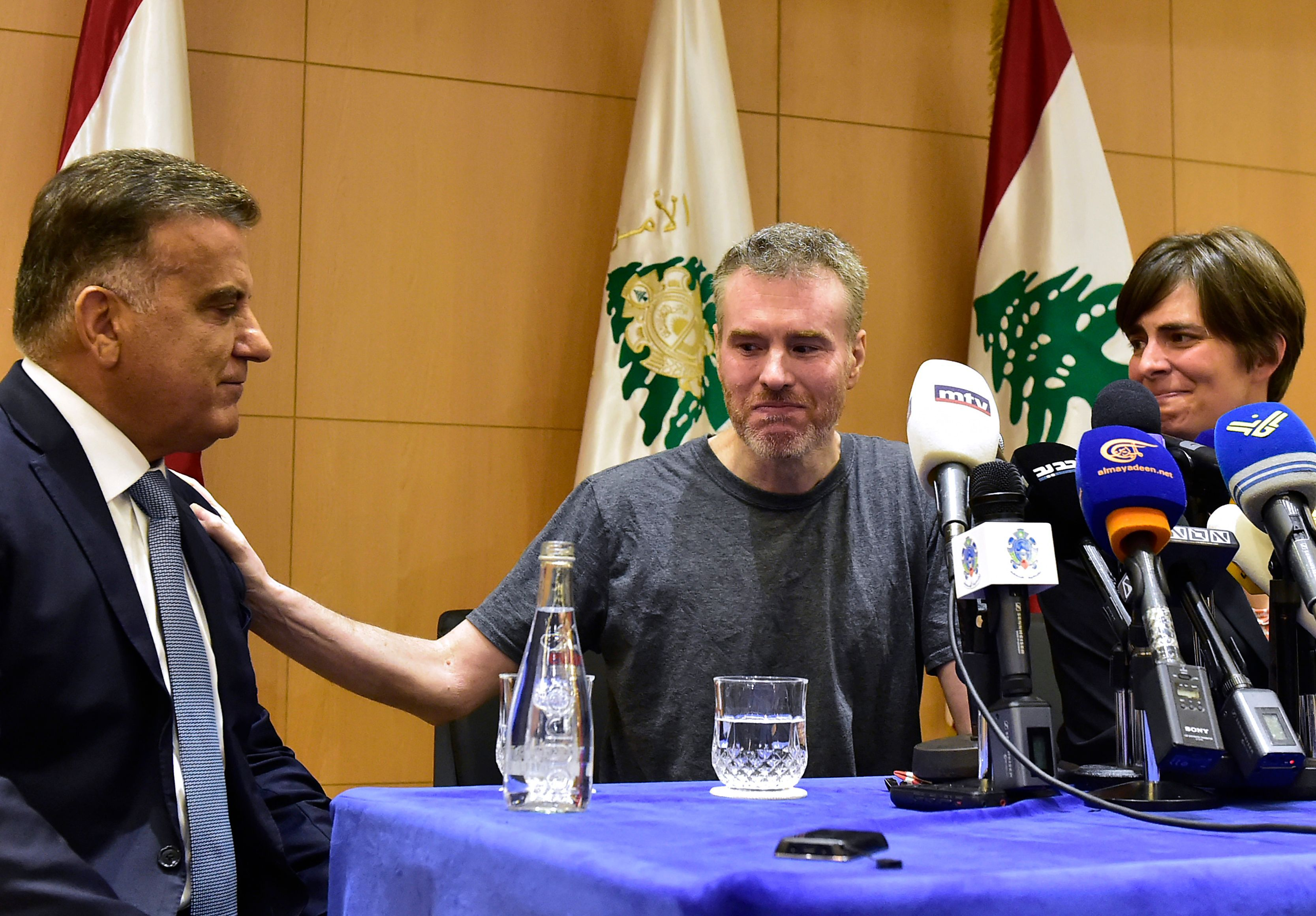 Canadian tourist, Kristian Lee Baxter, during a press conference in Beirut alongside the General Director of the Lebanese Security Abbas Ibrahim - 9 August, 2019 (AFP)
