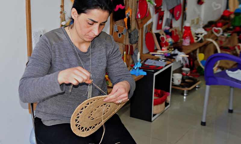 A woman folding making products from straw in Suwaida – July 3, 2019 (SANA)